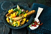 Tempeh with mango, shallots and chillis