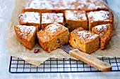 Pumpkin cake with cranberries and icing sugar