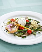 Green asparagus with a sage, stinging nettle and garlic pesto, risotto and cream cheese