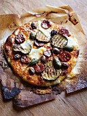 Pizza with grilled vegetables, capers and salami