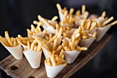 French fries in small paper cones