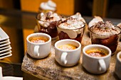 Crème brûlée and chocolate mousse with whipped cream