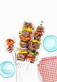 Grilled beef skewers with peppers and onions