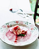 Vanilla ice cream with rosehip sauce and mint
