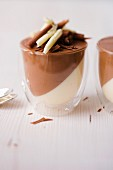 Ginger and chocolate mousse and chocolate and lemon mousse in glasses
