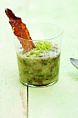 Barley and celery soup with Bresaola and green apples in a glass