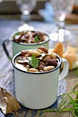 Clear oxtail soup with beans for a winter picnic (South Africa)