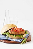 A grilled vegetarian burger on a wholemeal bun with tomato salsa
