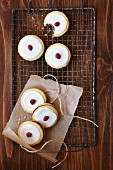 Sandwich biscuits decorated with icing and cranberries