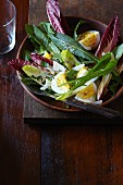 A green salad with egg and Parmesan