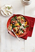 Greek-style spaghetti with chicken, feta cheese, olives, rapini and peppers