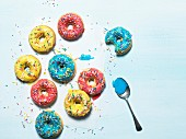 Colourful doughnuts on a blue surface