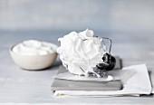 Sweet beaten egg white for making meringue on a whisk