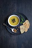 Cream of parsnip soup with curry, coriander and fried chickpeas