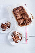 Brownies with pecan nuts, ice cream and caramel sauce