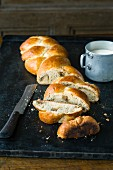 Homemade plaited bread with lemon marzipan and almonds