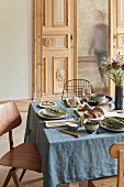 A table laid à la Provence with a blue linen tablecloth and scented decorations