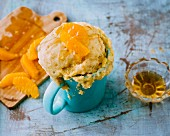 A mug cake with oranges and honey