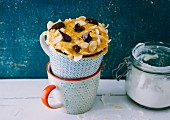 A banana boat-style mug cake with bananas and chocolate cream