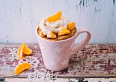 A mulled wine mug cake with apples, mandarins and a mascarpone topping