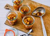 Homemade apple chutney with raisins in jars