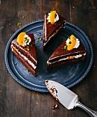 Three slices of gluten-free peach and chocolate cake