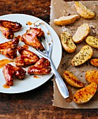 Marinated chicken wings with roasted caraway potatoes
