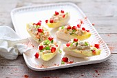 Chicory boats with cream cheese and pomegranate seeds
