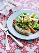 Pork chop with pesto and broccoli