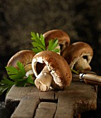 Brown mushrooms with flat-leaf parsley and a knife
