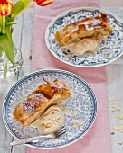 Two plates of apple strudel with vanilla ice cream