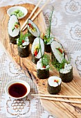Maki sushi with vegetables and herbs