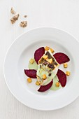 Branzini on roasted beetroot with wasabi sauce and celery croutons