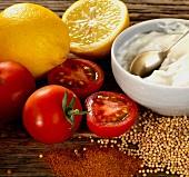 Lemons, tomatoes, mustard seeds, chilli powder and mayonnaise