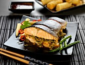 Thai-style stuffed roasted salmon with green beans and baby corn