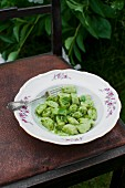 Broad bean gnocchi with basil pesto