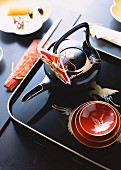 Toso (spiced sake for New Year, Japan) in a teapot with bowls