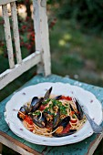 Spaghetti with tomato sauce, mussels and parsley