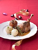 Festive goose leg with potato dumplings and baked apples
