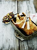 Roast goose in a roasting tin served with beetroot with walnuts
