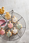 Iced dreidel biscuits on a wire rack