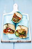 Pancake wraps with smoked salmon, rocket, herbs, cucumber and radishes