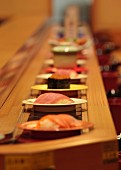 Sushi on a conveyor belt in a restaurant