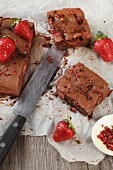 Chocolate tray bake cake with a strawberry cream filling and pink pepper