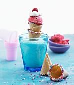 Raspberry sorbet in mini cones with sugar sprinkles