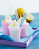 Lemon sorbet in pink plastic cups