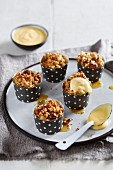 Mini apple bakes with oat and nut caramel and vanilla sauce