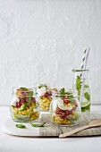 Sweet corn salad with bacon and aioli in jars