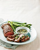 Roast beef with green asparagus and green sauce