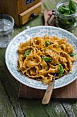 Pasta with tomato and almond pesto